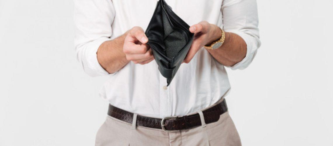 close-up-portrait-man-showing-empty-wallet_171337-17551